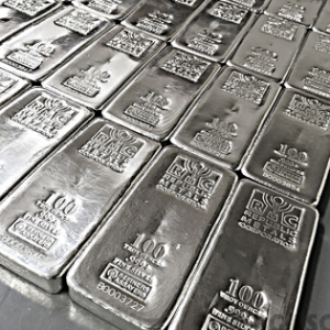 Gold slides on low demand, silver remains steady